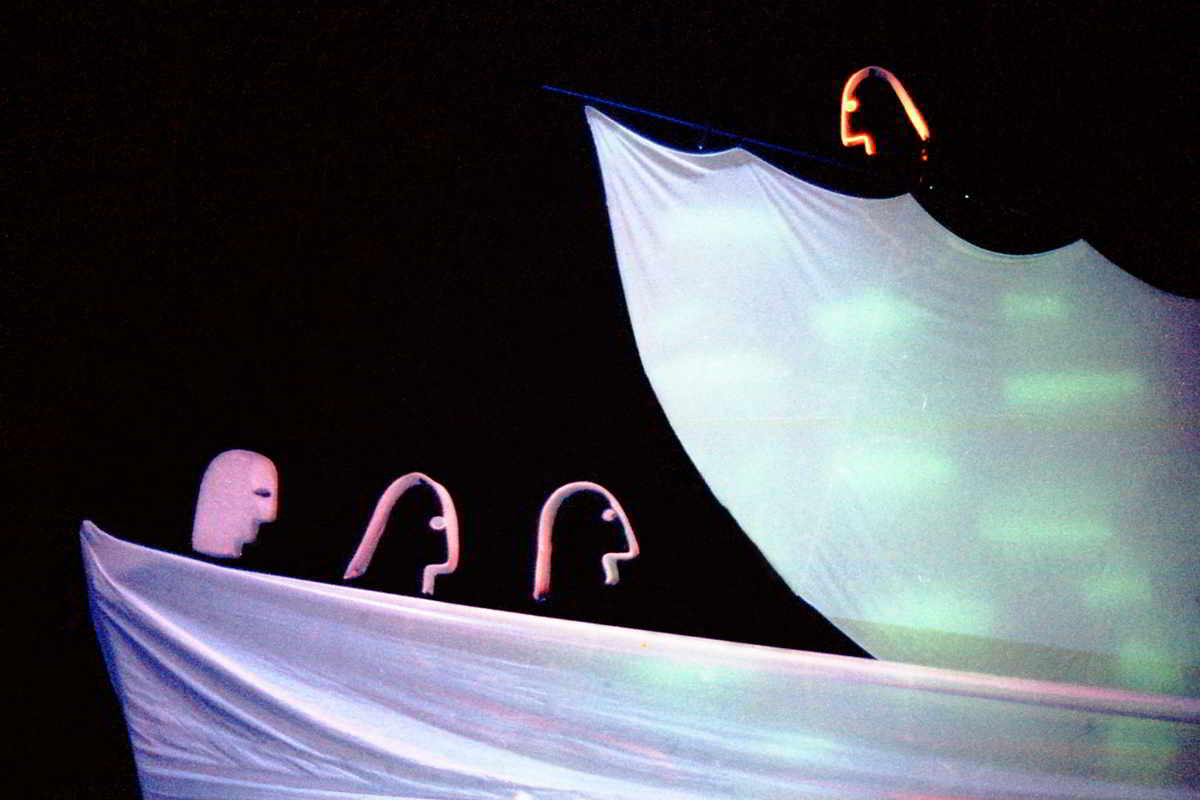 Handspan Theatre Four Little Girls Four puppet heads in a simple boat