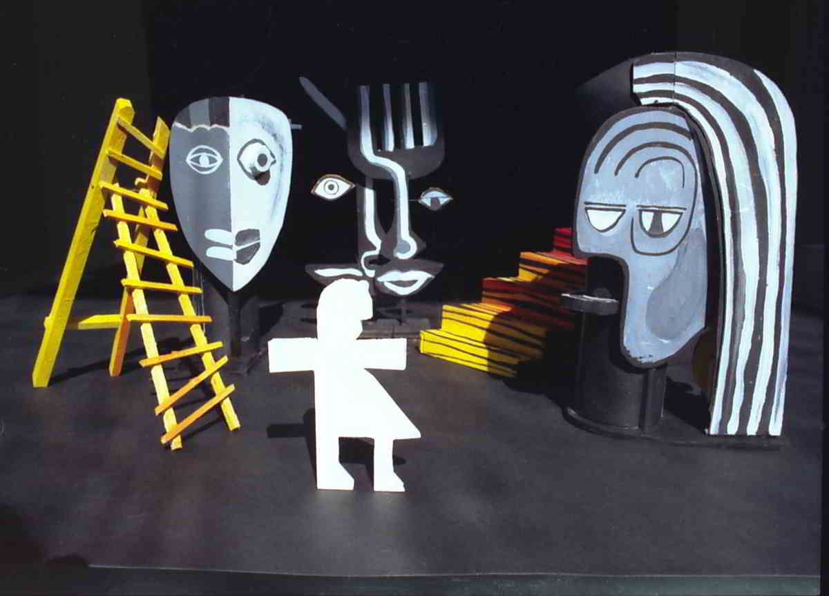 cardboard cutouts of model picasso-esque painted set