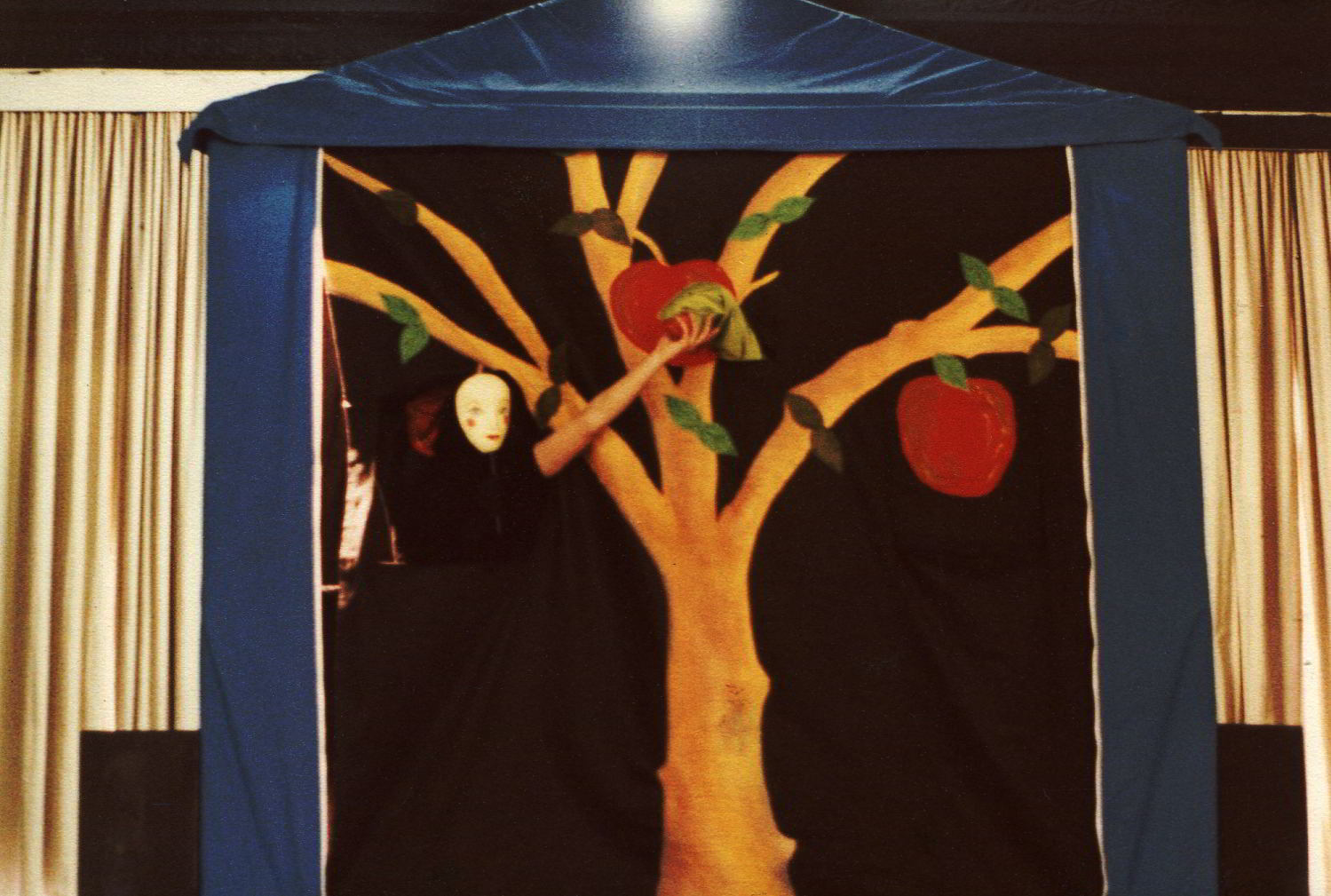 Handspan Theatre The Apple Show set up - blue tent with an appliqued apple tree across its front side