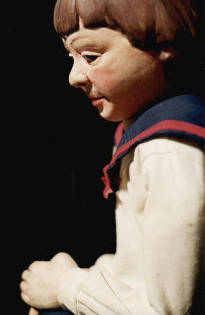 side view of puppet boy wearing a sailor suit