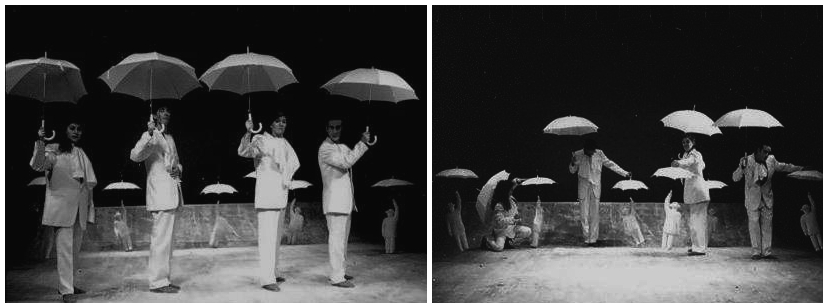 4 performers on stage holding umbrellas and working puppet figures at their feet