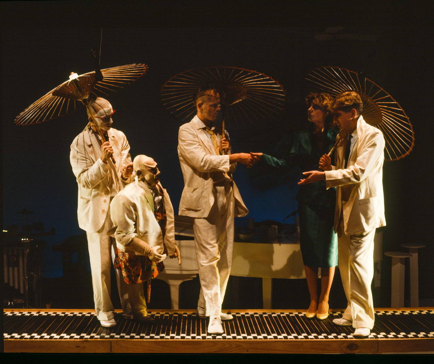puppets and people under parasols on forestage