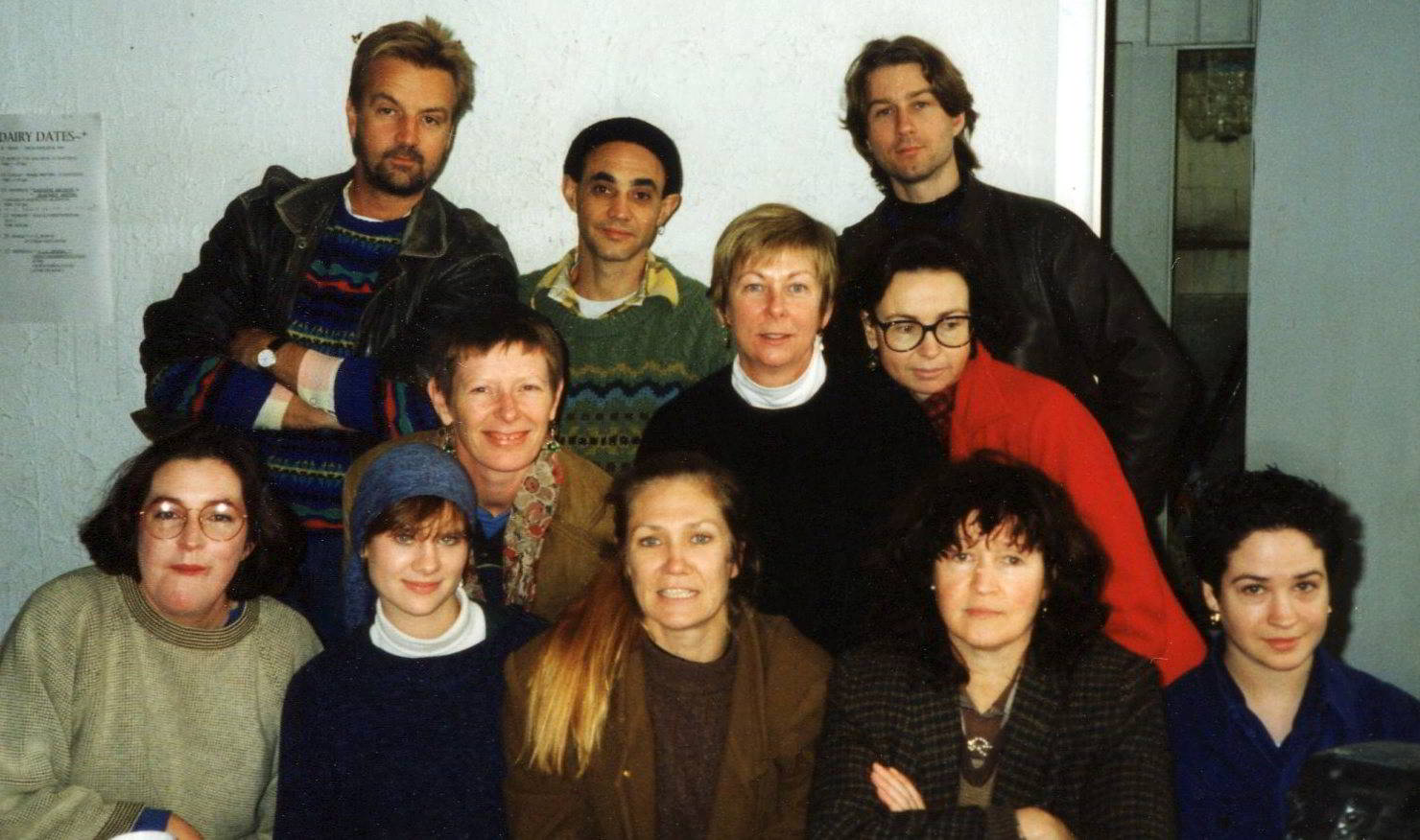 group photo of eleven people in winter clothes