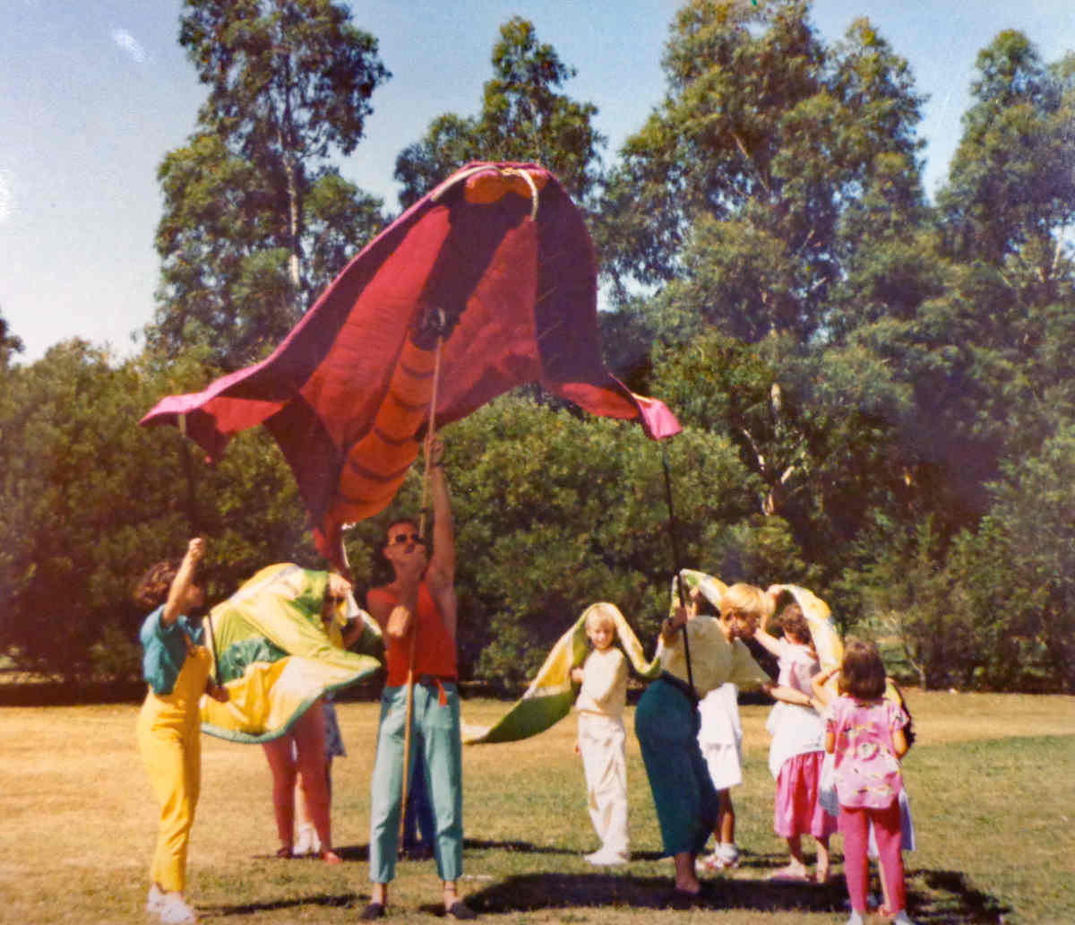 Andrew Handsen, Handspan Theatre man with children flying a butterfly puppet