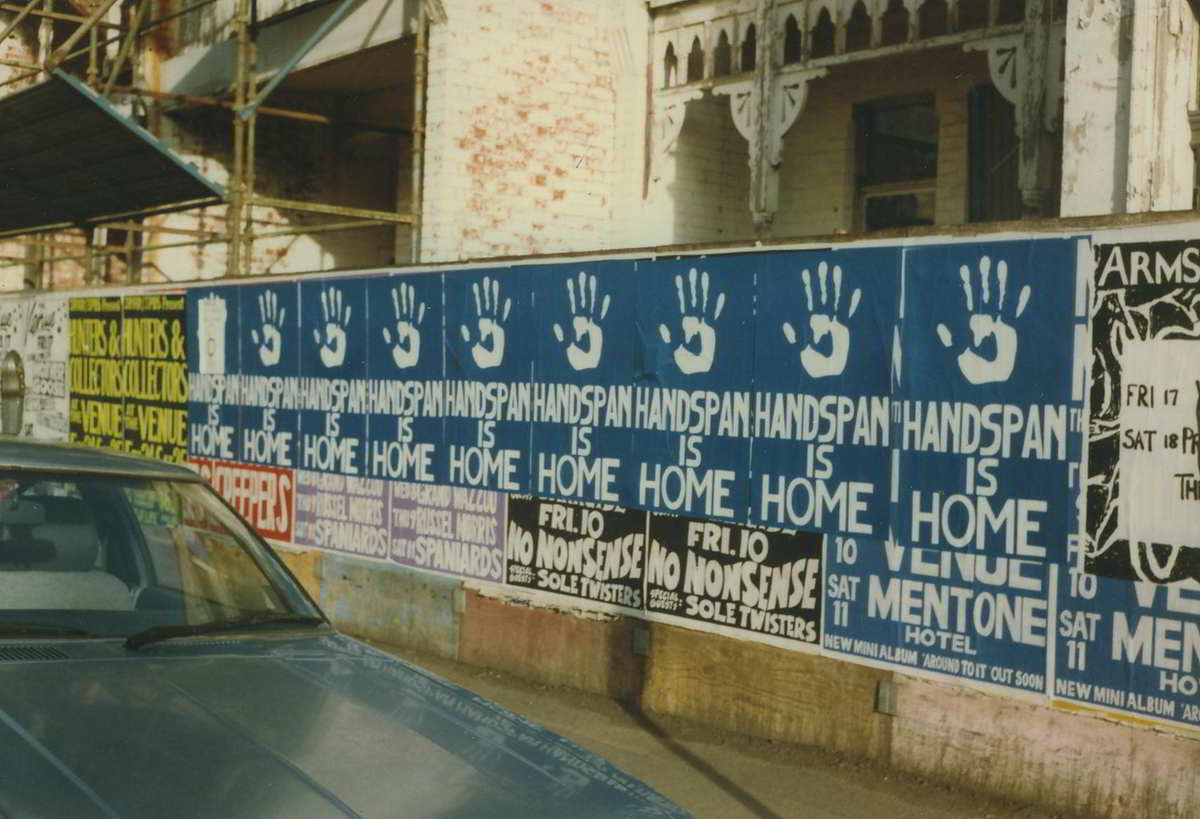 Handspan At Home posters on street hoarding