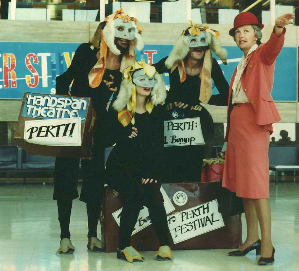 people dressed in bunyip costumes with TAA staff at airport