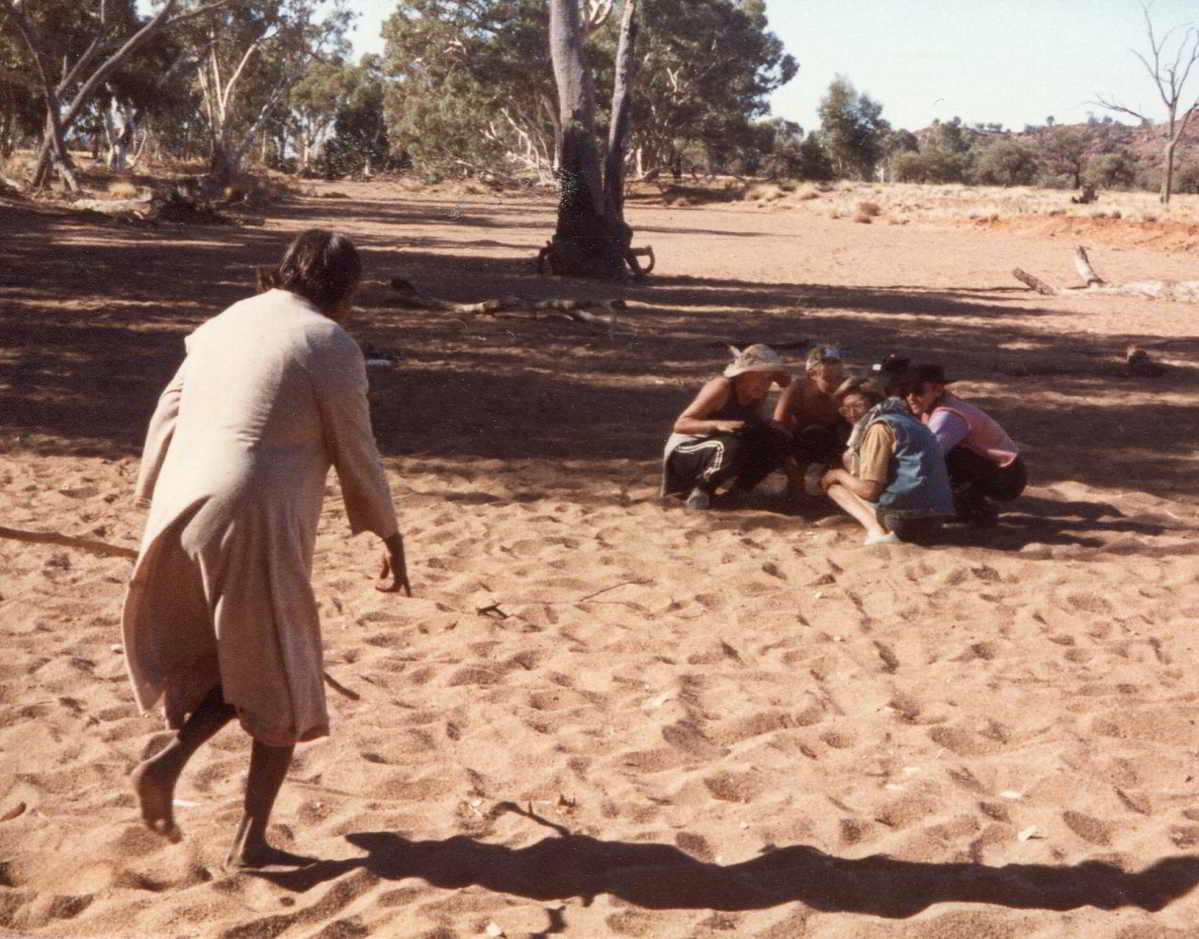 Handspan Theatre The Haunted indigenous woman running towards a group of crouching white fella women across sand