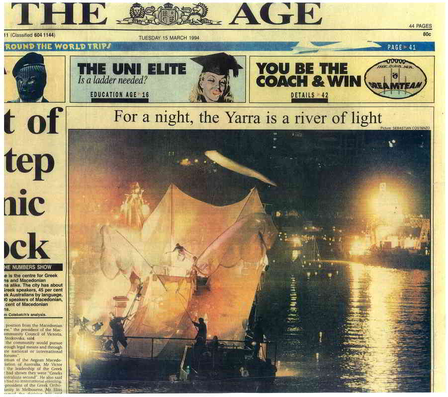Newspaper cutting showing photo of barge on river at night