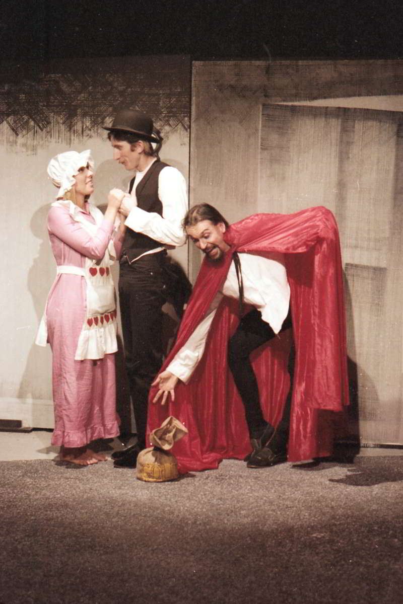 Jandy Malone and the Nine O'Clock Tiger, Handspan Theatre, a melodramatic scene of a man and woman circa 1850s being confronted by a villian in a red and black cloak