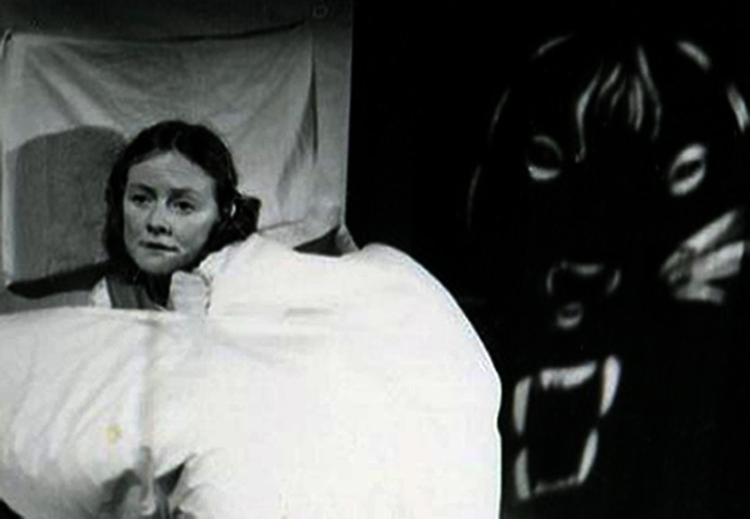 Jandy Malone and the Nine O'Clock Tiger, Handspan Theatre Jandy in bed frightened of tiger face looming behind her