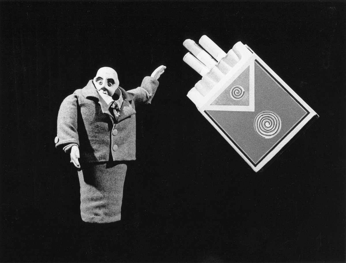 Handspan Theatre Lunatic Soup puppet man offering cigarettes