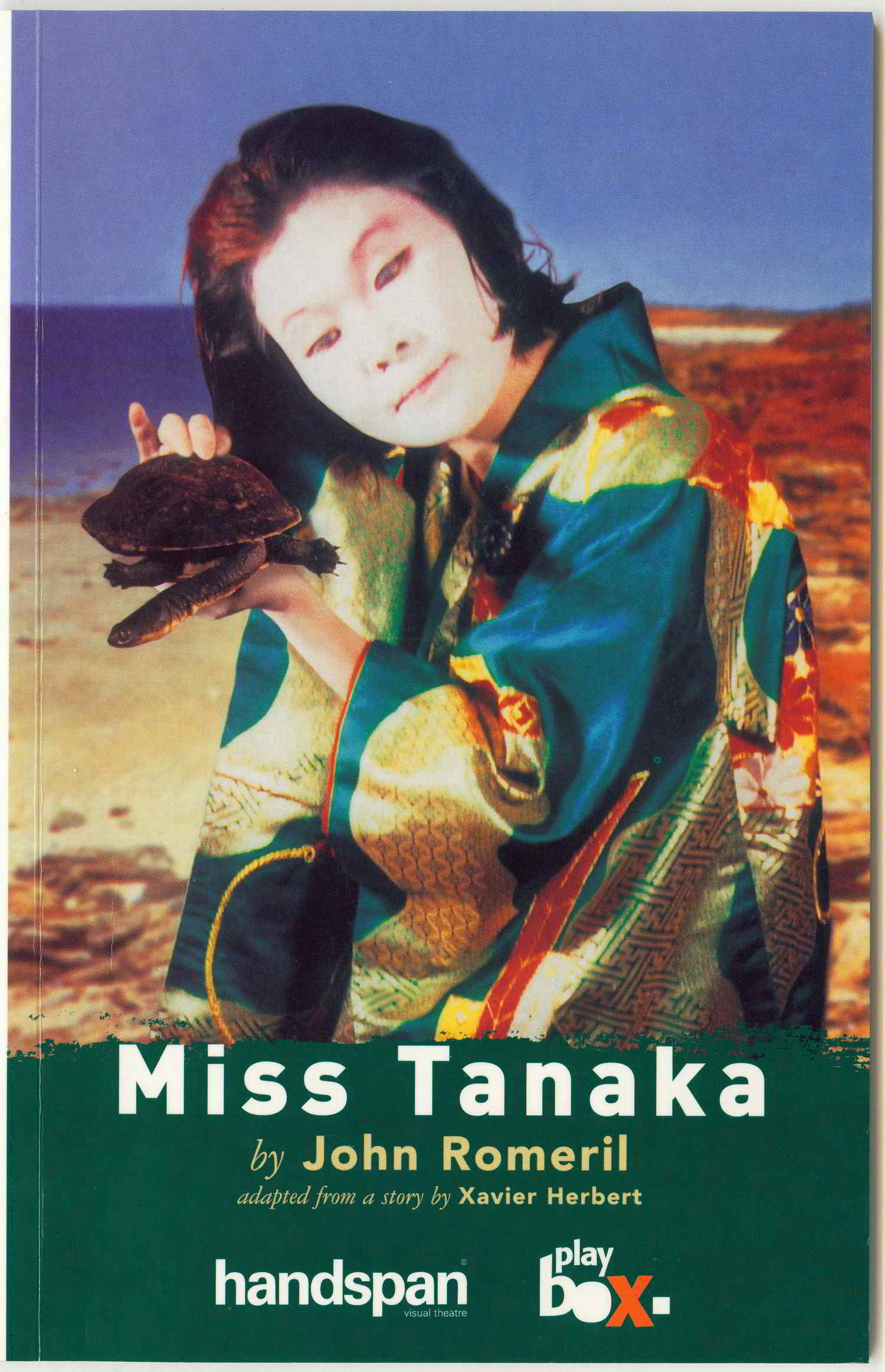 Miss Tanaka Handspan/Playbox painting of a girl in traditional Japanese dress holding a turtle on a beach with printed show credits below