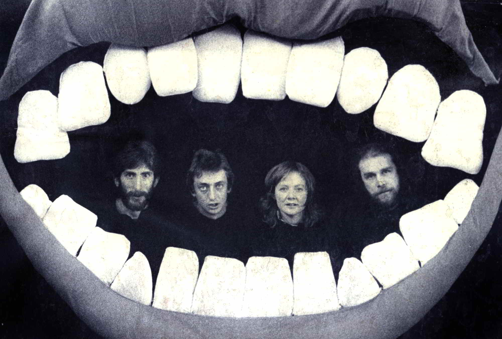 portrait of four people's heads inside the mouth