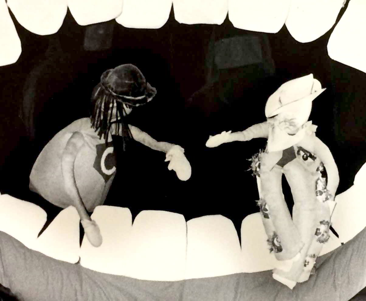 Handspan Theatre The Mouth Show teethcleaning heroes: puppets posing facing each other in the open mouth
