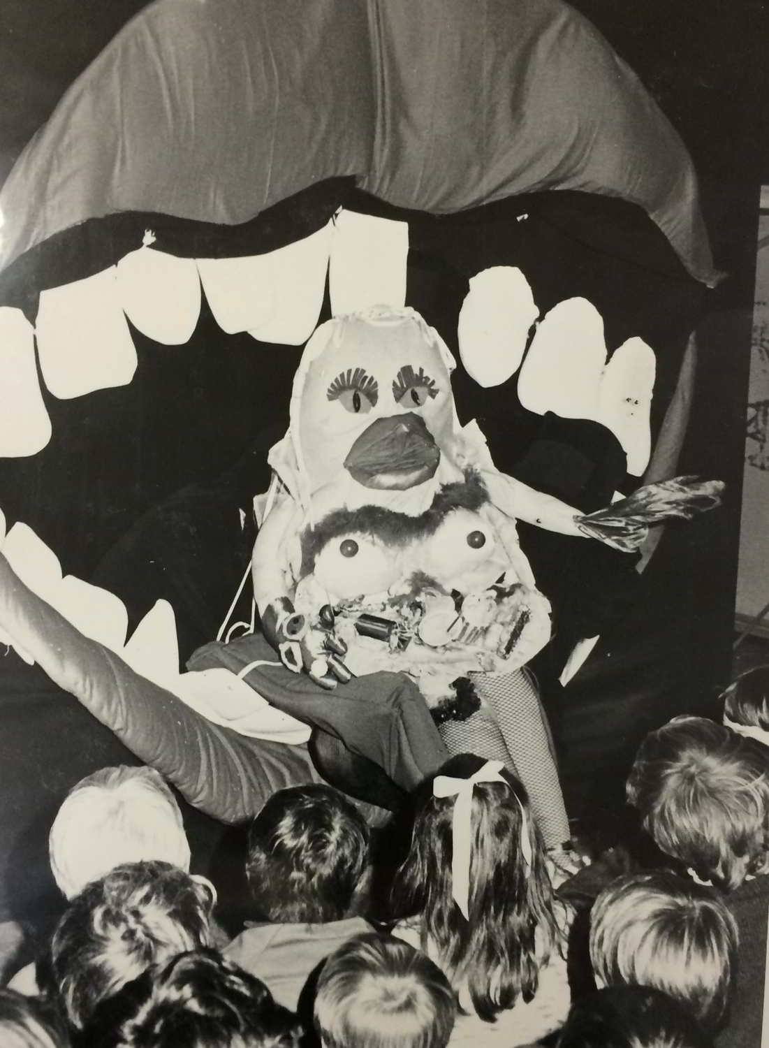Handspan Theatre The Mouth Show, Sugar, a garish puppet with ice-cream breasts and cherry nipples being rolled into the mouth by its tongue