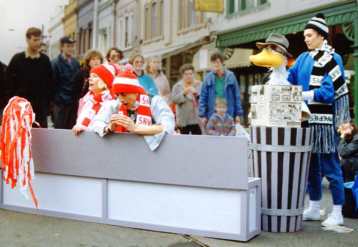 street performance duck puppet with puppeteer/actors wearing football scarves
