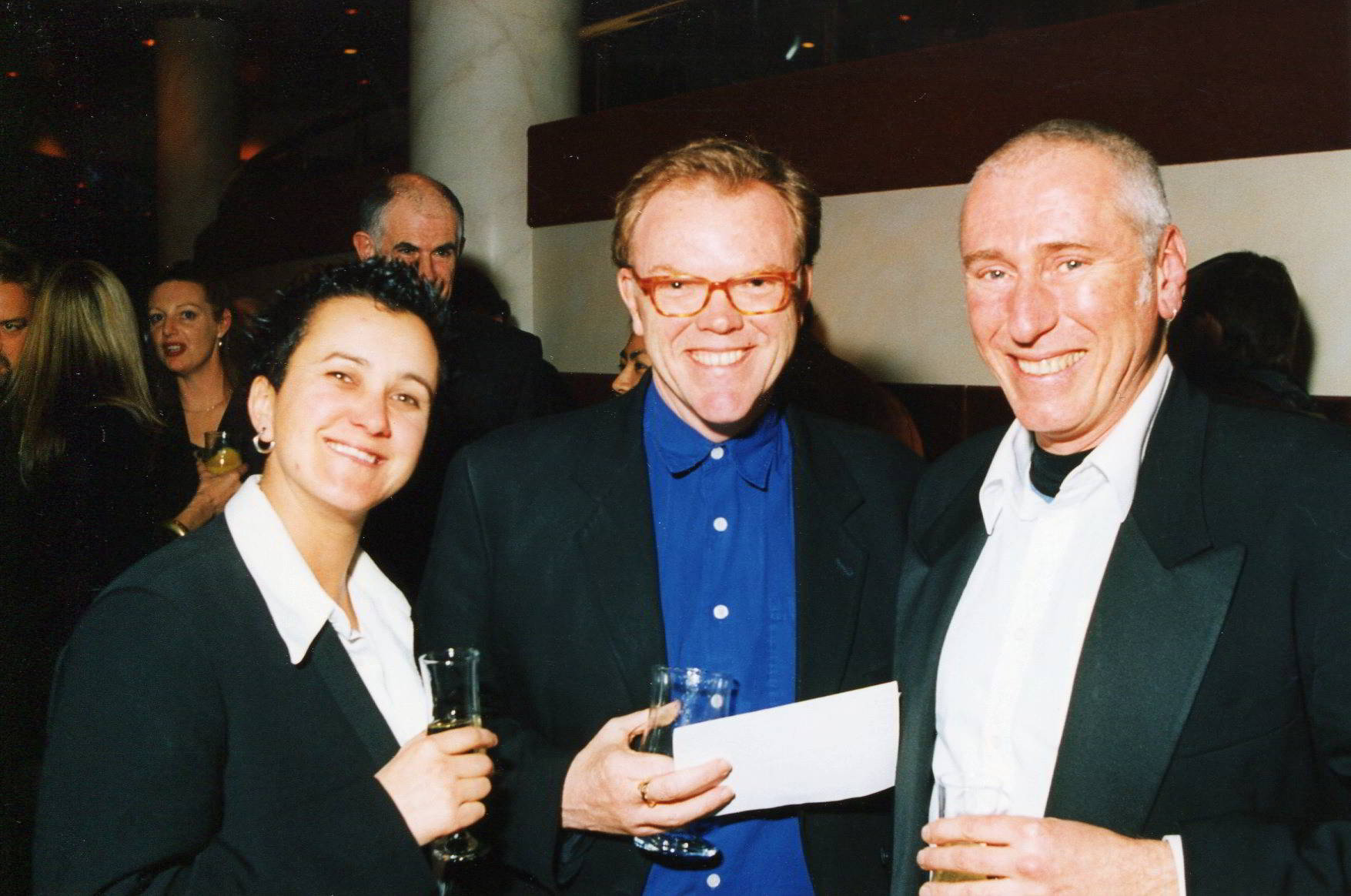 __Artistic Director David Bell__ with Megan Cameron and Rod Primrose 2 party goers posing