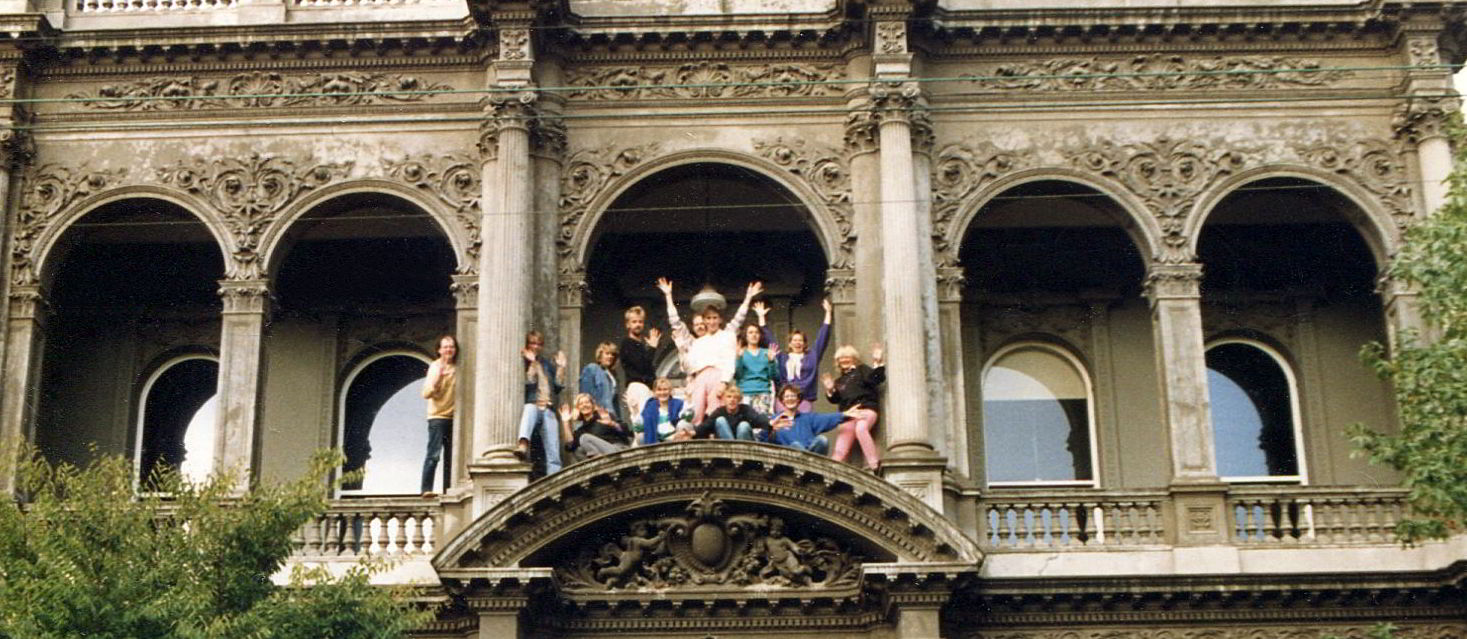 Handspan Theatre Dreaming 1986 company members on the verandah edge of an ornate Victorian building