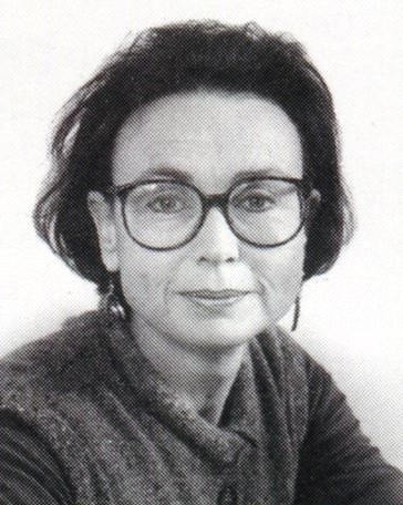 Laurel Frank black and white head shot of a dark-haired woman wearing glasses