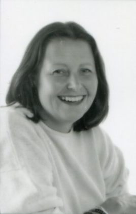 black and white portrait of smiling woman