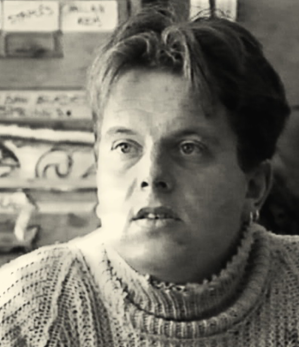 man's face in woollen high neck jumper