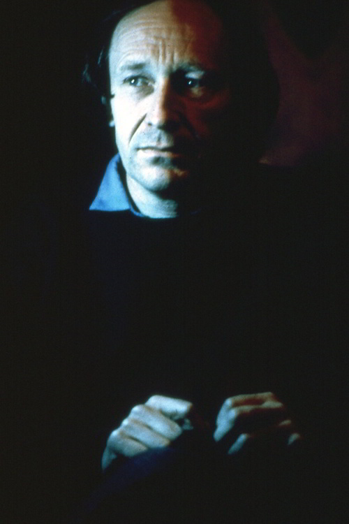portrait of a man in a dark blue jumper