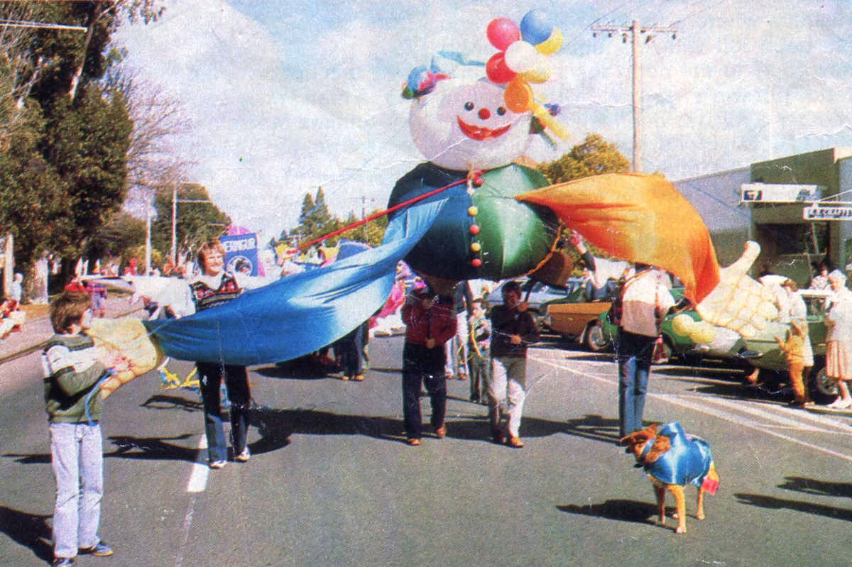 Street Parade led by helium balloon gnome puppet children and adults on a Mildura street,