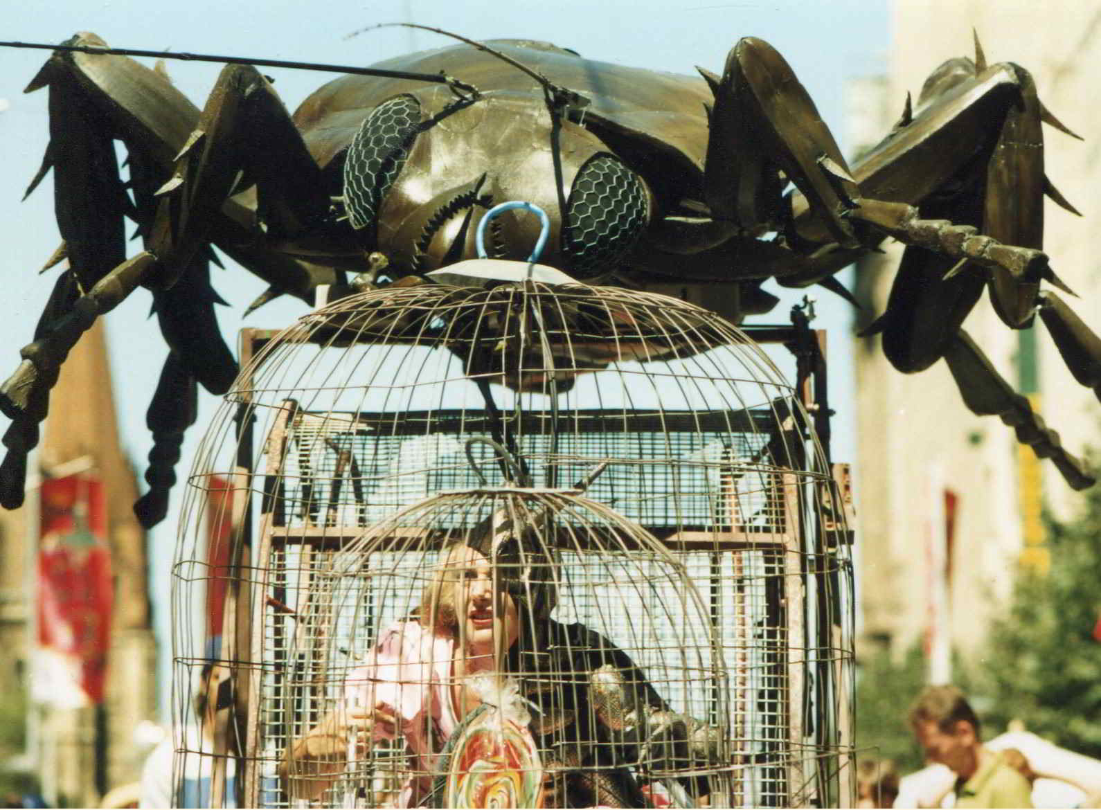 Road Roach parade image large cockroach head on top of cage with woman inside