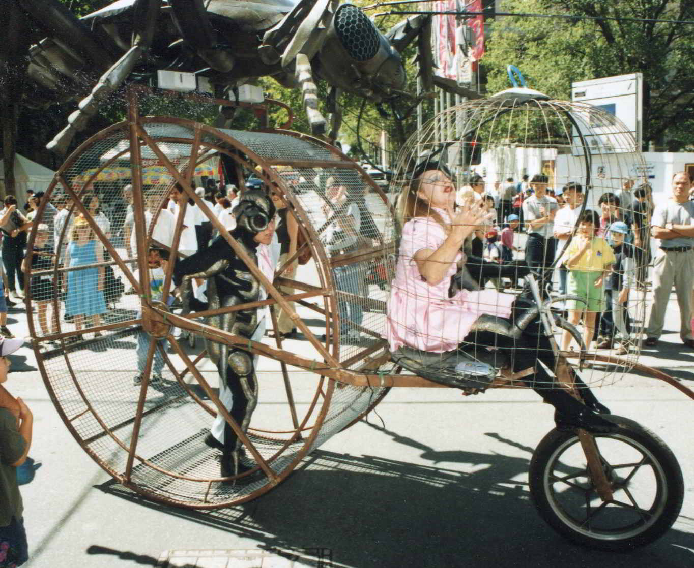 Road Roach side view of parade contraption showing wheel and first cage