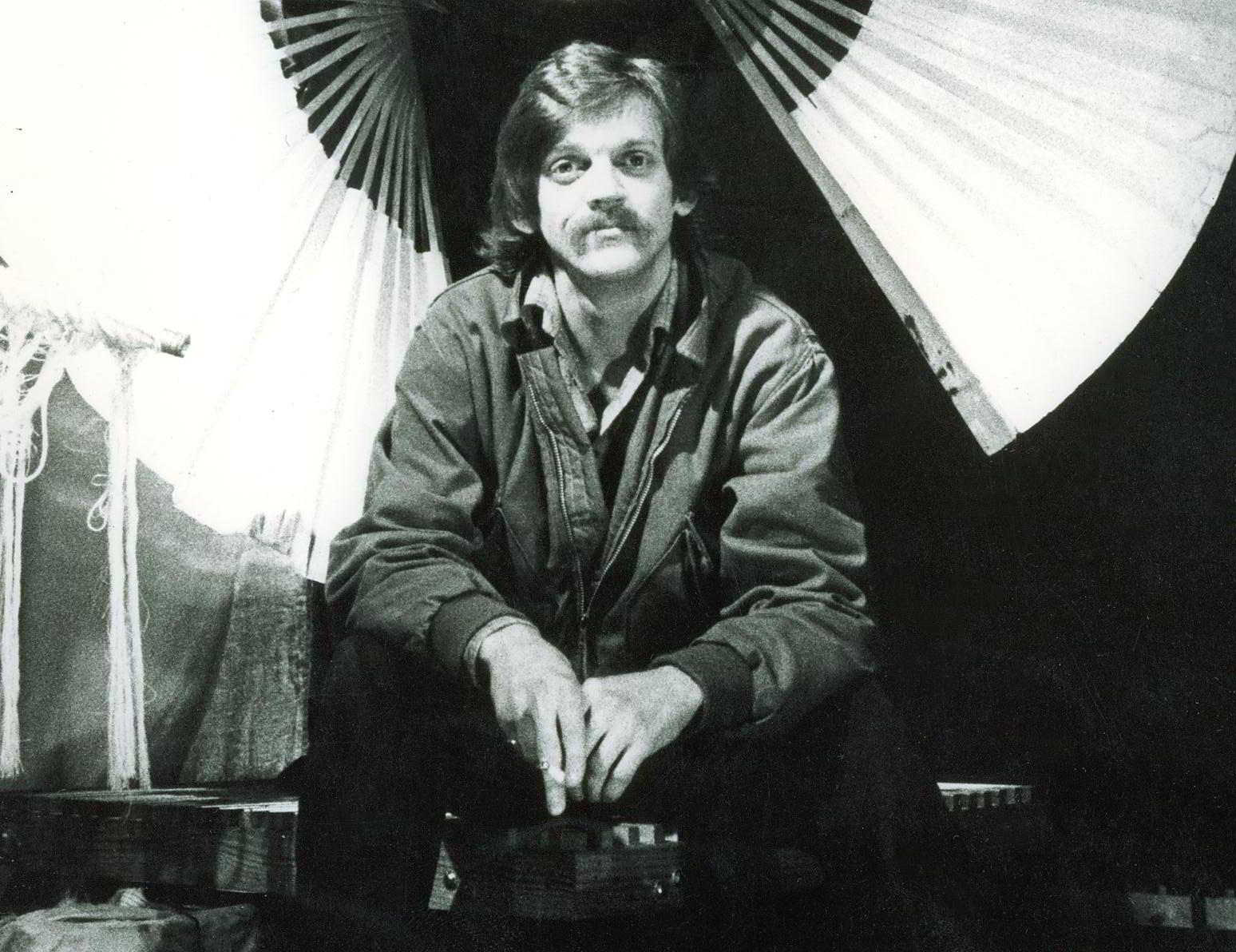 Secrets Handspan Theatre 1983 portrait of Nigel Triffitt seated
