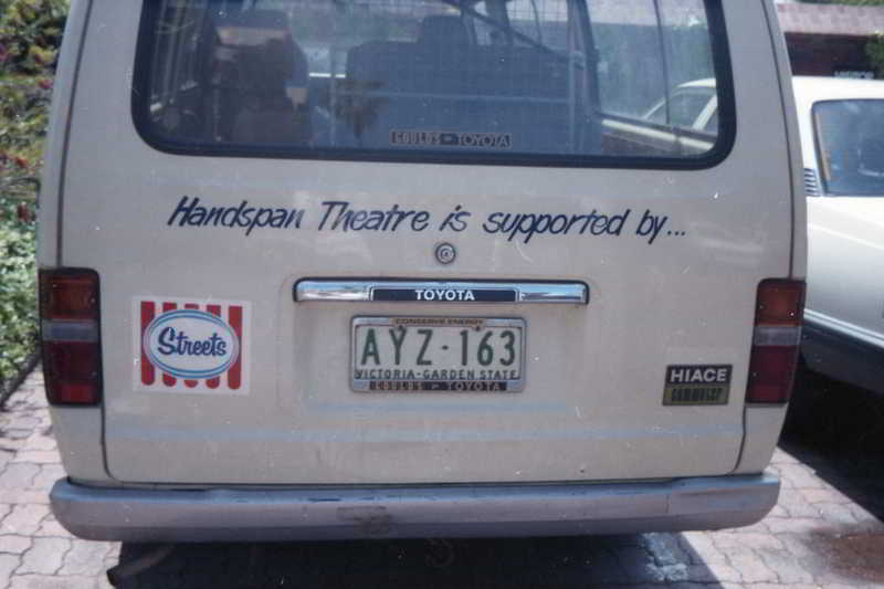 Handspan Theatre touring van - back of a white hiace van displaying streets logo