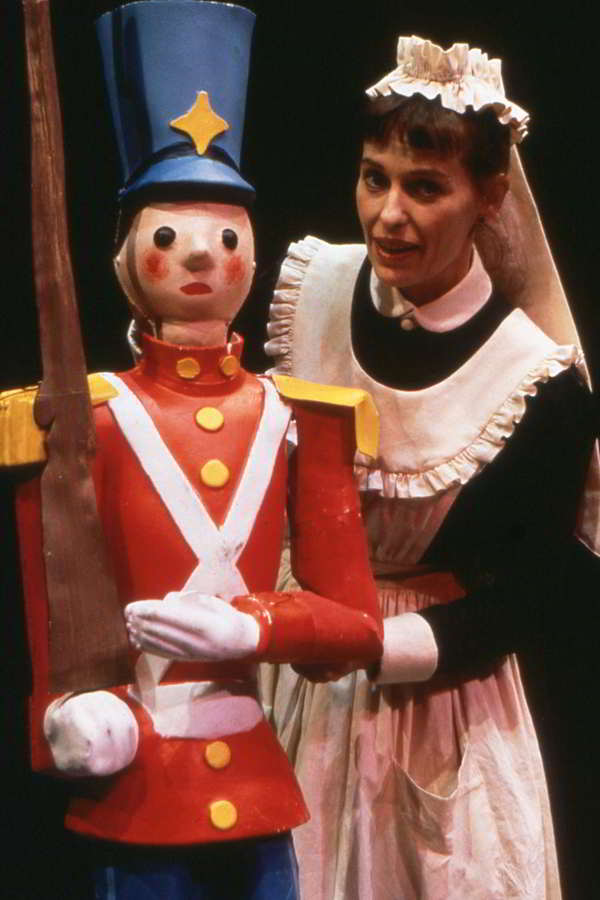 The Tin Soldier Handspan Theatre Woman dressed as a maid with a wooden soldier