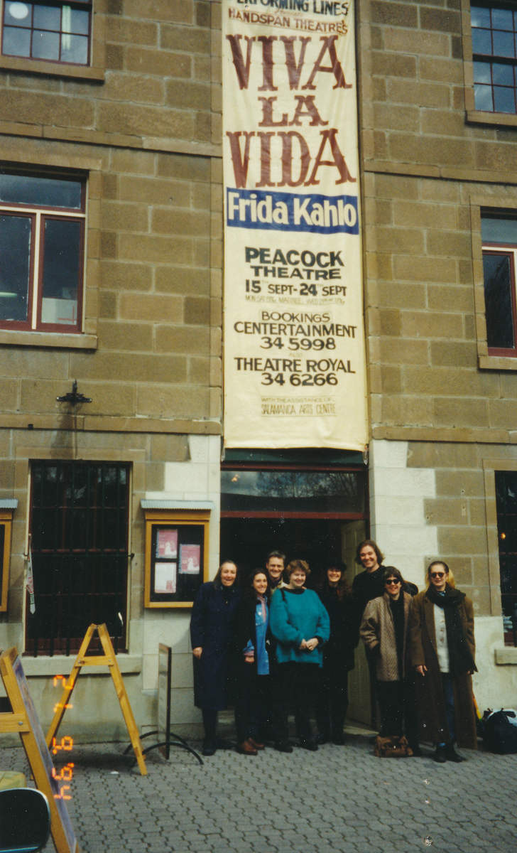 Handspan Theatre Viva La Vida - Frida Kahlo company on tour in theatre doorway with advertising banner