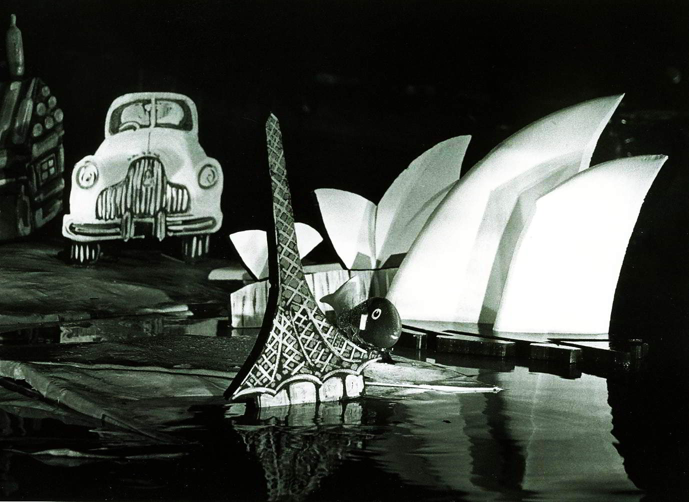 black and white photo cut outs of FJHolden, opera house and Melbourne arts centre spire
