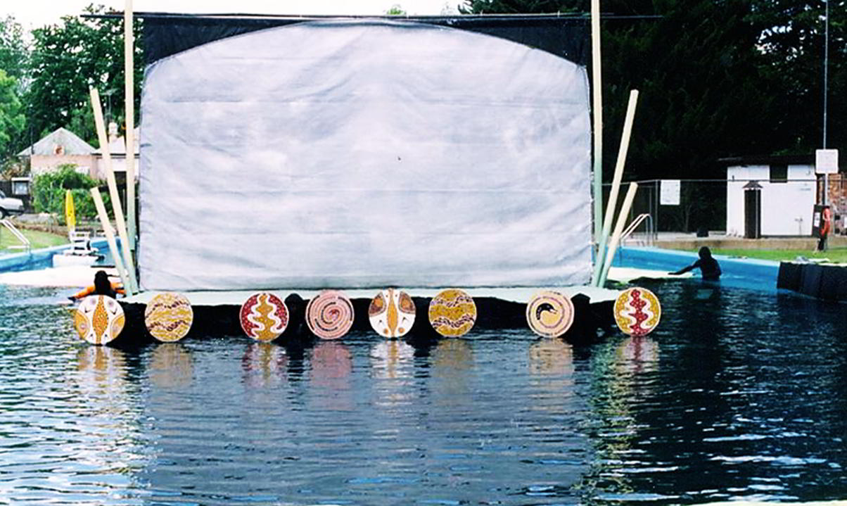 Waves of Change Handspan Theatre Castlemaine Festival stage in the pool dressed with circles of indigenous Australian design along its front