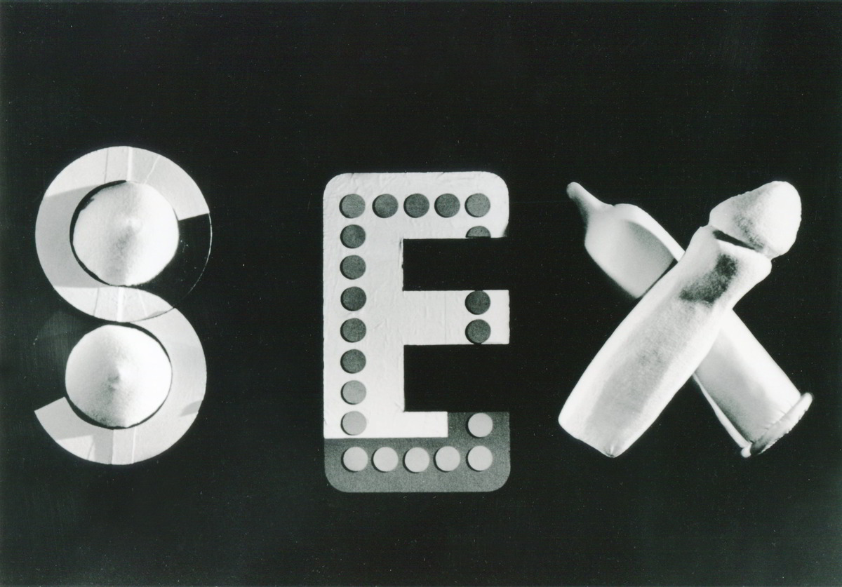 black and white picture baby bottles, merangues and domino object making the word SEX