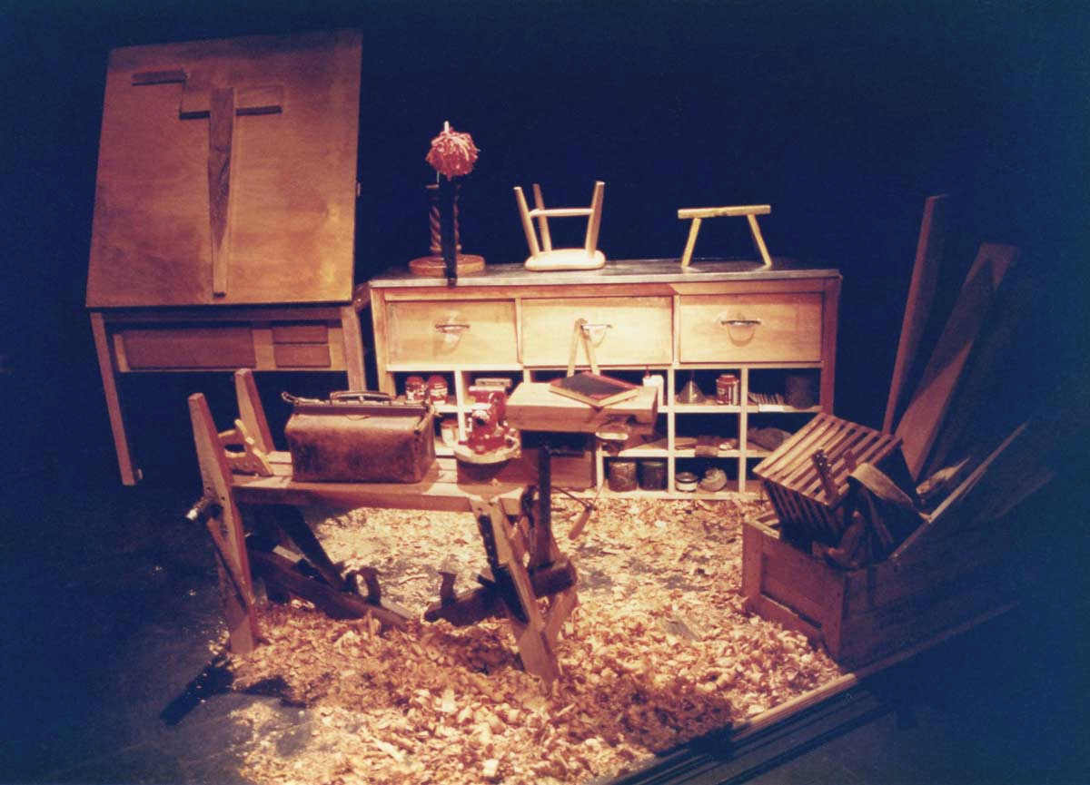 The Wooden Child Handspan Theatre carpenter's workshop with benches, tools and floor covered with wood-shavings