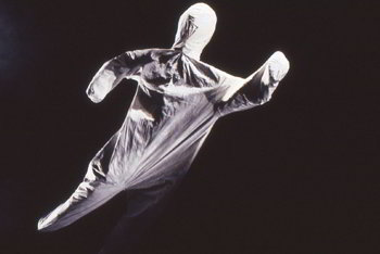 simple figure covered in white cloth moves in mid-air